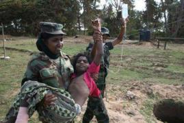 Soldiers caring for wounded civilians www.army.lk